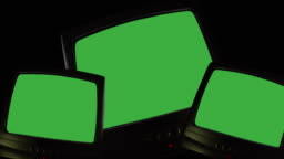 Three vintage TVs on black background, televisions switching on green screen, chroma key screens for pictures, videos or writing. TV screen changing colors, noise static or bad signal reception