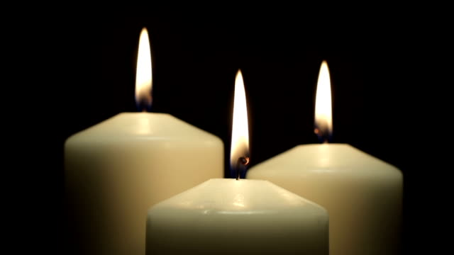 three white candles burning in the dark - three objects stock videos & royalty-free footage