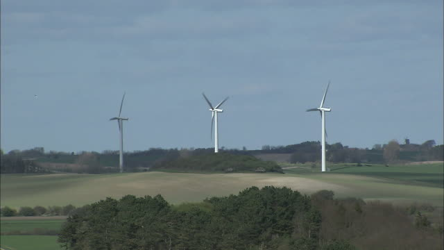 three wind turbines produce clean energy. - nordic countries stock videos & royalty-free footage