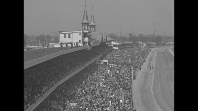 three woman in hats look over the program for the 1940 race / an aerial view of the massive crowd and a view from the grandstands / three people... - telephoto lens stock videos & royalty-free footage