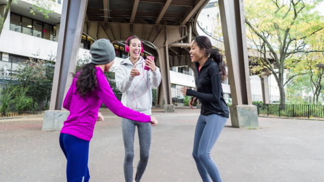 Three women celebrating a new record running time in New York