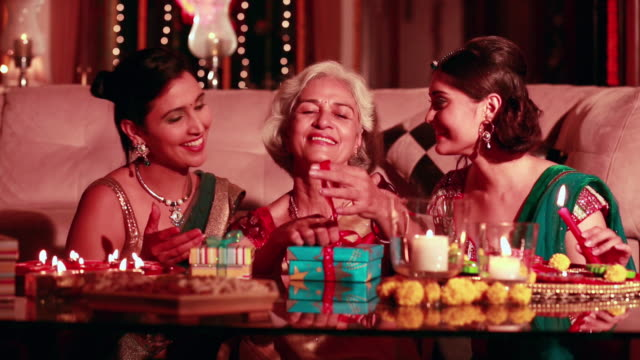 Three women celebrating diwali festival