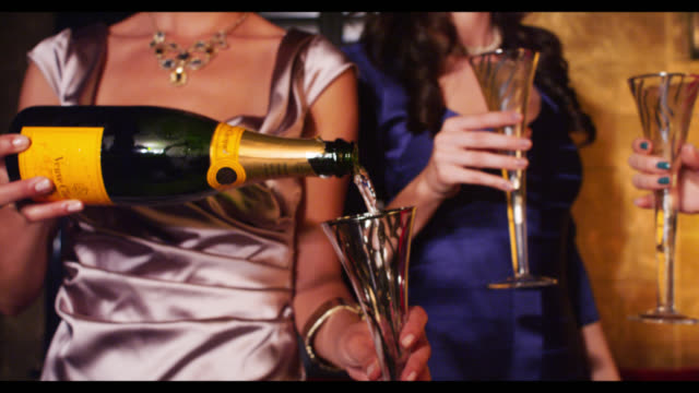 three women champagne being poured - champagne stock videos & royalty-free footage