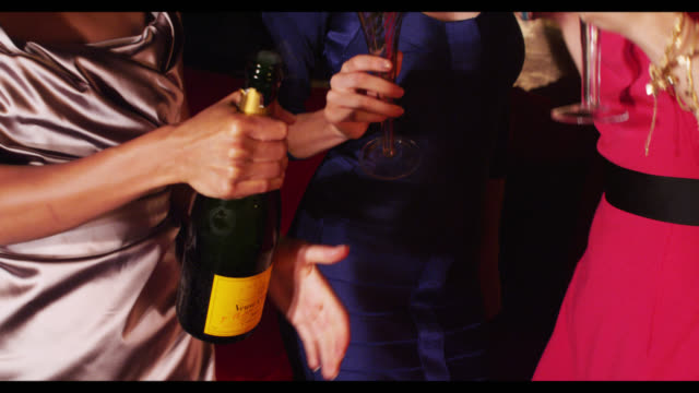 vidéos et rushes de three women champagne bottle opened. - champagne