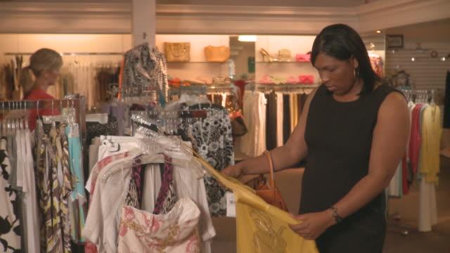 MS Three women choosing clothes in boutique / Richmond, Virginia, USA