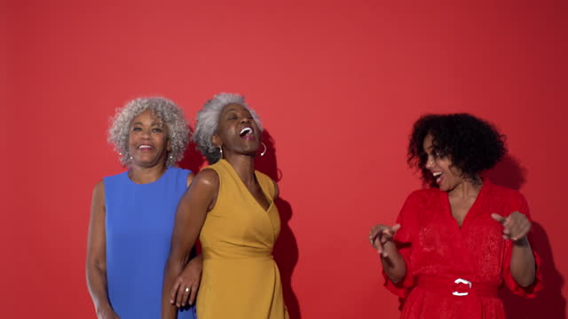 three women dance together - grey hair stock videos & royalty-free footage