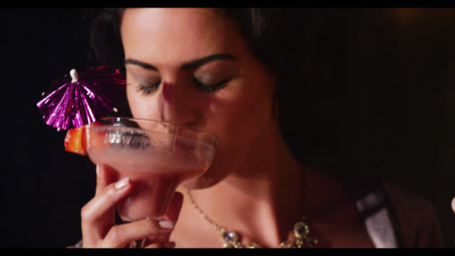 vidéos et rushes de three women dancing with cocktail drinks - drinking health 1930 film