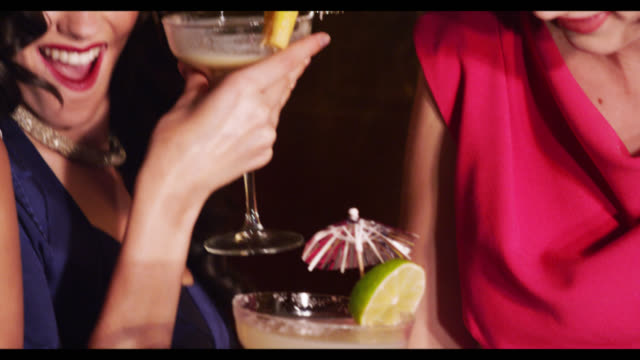 three women dancing with cocktail drinks - ladies' night stock videos and b-roll footage