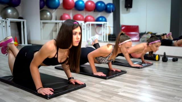 three women doing push ups - bodyweight training stock videos & royalty-free footage