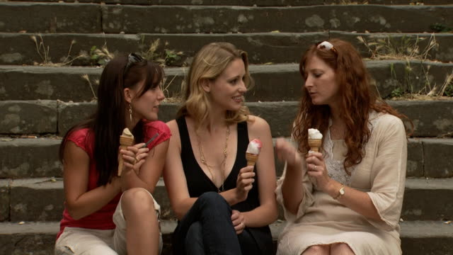 three women eating ice cream on outdoor stairs - see other clips from this shoot 1150 stock videos and b-roll footage