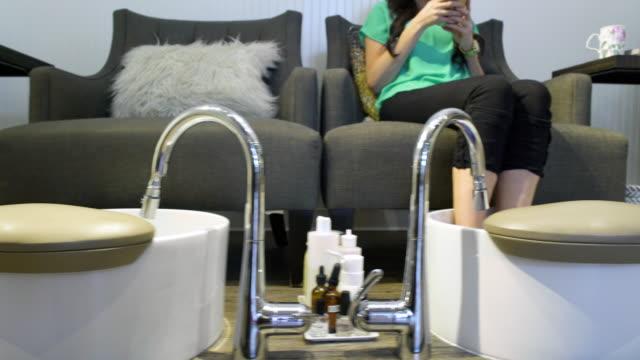 Three women getting a pedicure in a spa