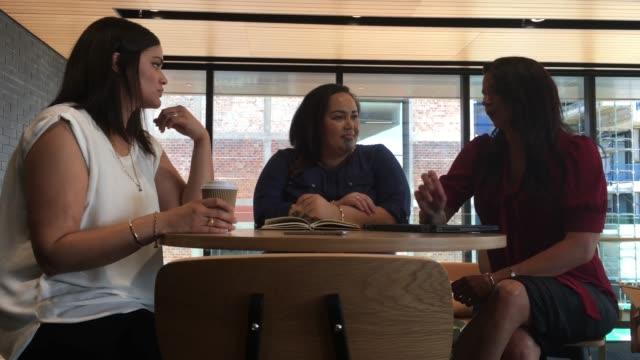three women having a coffee break - coworker stock videos and b-roll footage