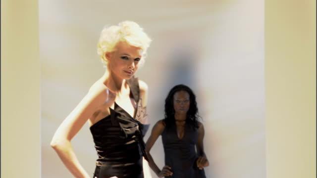 vidéos et rushes de ms three women in dresses and man in suit modeling on catwalk / london, england, uk - 1 minute et plus