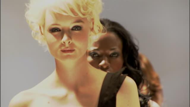 cu ms three women in dresses modeling on catwalk / london, england, uk - この撮影のクリップをもっと見る 1064点の映像素材/bロール