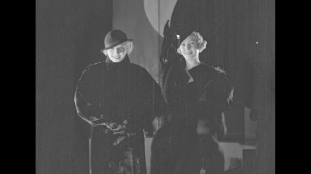 three women in fur jackets and hats, one woman wearing stole and carrying muff in staged indoor setting / two models stand facing camera, one in dark... - full length bildbanksvideor och videomaterial från bakom kulisserna