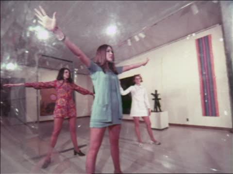 1970 three women modeling mini-dresses posing in clear plastic bubble in art museum / atlanta - fashion show video stock e b–roll