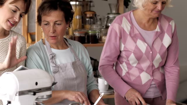 three women preparing lunch together - recipe stock videos & royalty-free footage