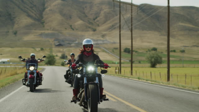 three women riding motorcycles on remote road / payson, utah, united states - payson stock videos & royalty-free footage