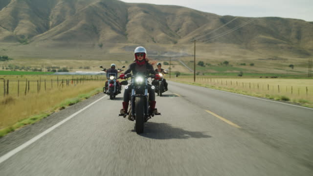 vidéos et rushes de three women riding motorcycles on remote road / payson, utah, united states - payson