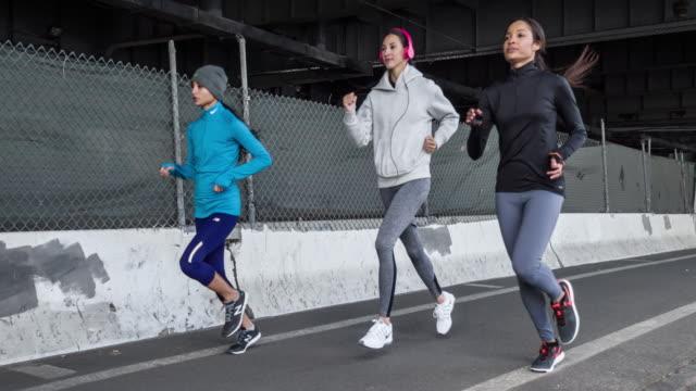 Three women running in New York