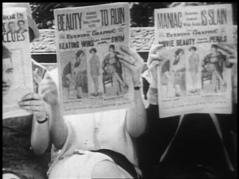 b/w 1925 three women sitting on bench reading newspapers / newsreel - journalism stock videos & royalty-free footage