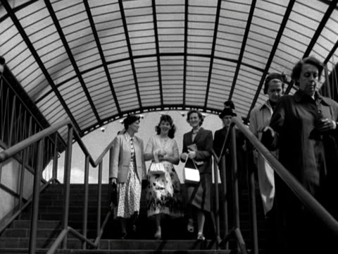 three women walk down covered steps towards the camera at the festival of britain site 1951 - festival of britain stock videos & royalty-free footage