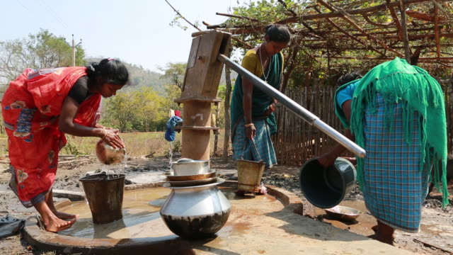 ws of three women who are washing different kinds of crockery at water pump in a small village in a rural area about 300 kilometer from kolkata india - water pump stock videos & royalty-free footage