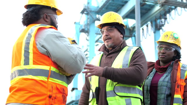 three workers talking, working at shipping port - foreman stock videos and b-roll footage