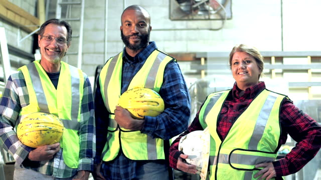 three workers with hardhats and safety vest - construction worker stock videos & royalty-free footage