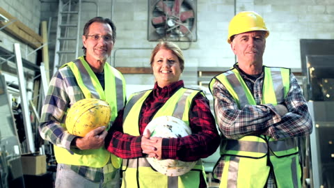 three workers with hardhats and safety vest - work helmet stock videos & royalty-free footage