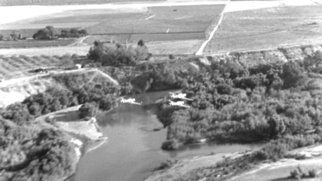 three wwii trainer aircraft fly in close formation over farmland in texas. - 1940 video stock e b–roll
