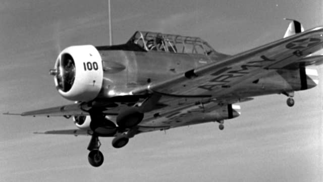 stockvideo's en b-roll-footage met three wwii trainer aircraft fly in close formation. - 1940