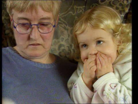 broken leg fiasco england doncaster courtney blake sitting with mother on sofa with leg in plaster courtney blake along into room and sits in sofa cs... - broken leg stock videos & royalty-free footage