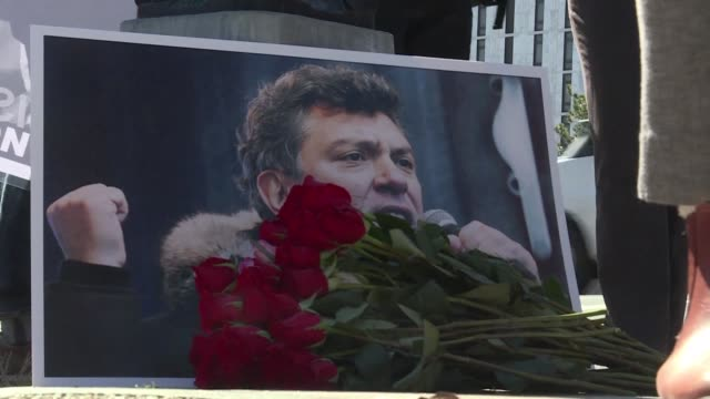 three years after prominent vladimir putin critic boris nemtsov was assassinated in moscow the liberal politician's supporters gather to name a plaza... - critic stock videos & royalty-free footage