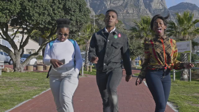 three young african friends dancing along the street in cape town - cape town stock videos & royalty-free footage