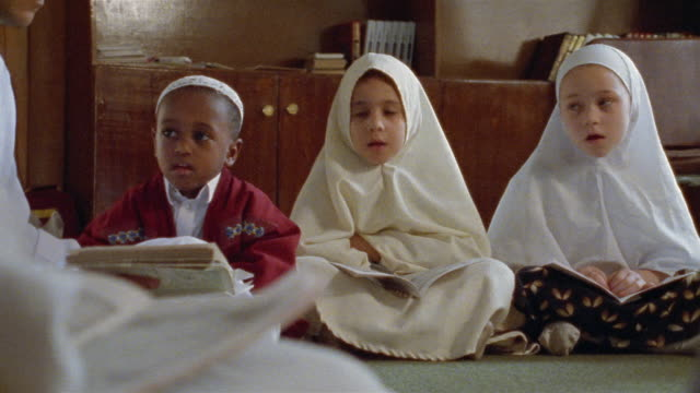 ms three young children reading texts in religion class / cairo, egypt - islam stock videos & royalty-free footage