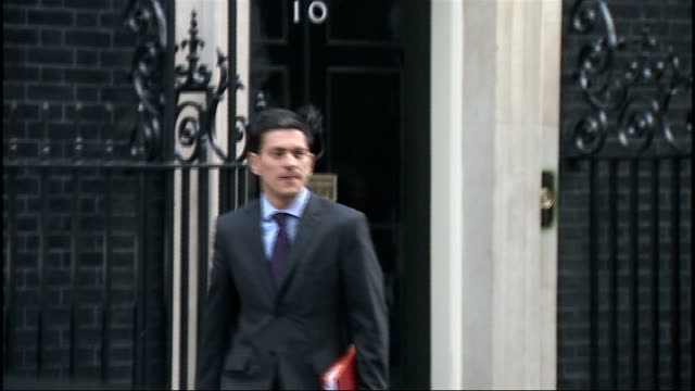Three young competition winners attend Cabinet meeting EXT David Miliband MP chatting to Jim Murphy MP as leaving No10 then walking away along road