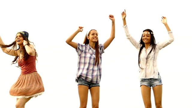 Three young female friends jumping, isolated,slow motion