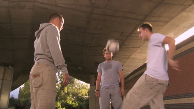 ms tu three young men exercising with soccer ball underneath overpass, london, uk - stunt stock videos & royalty-free footage