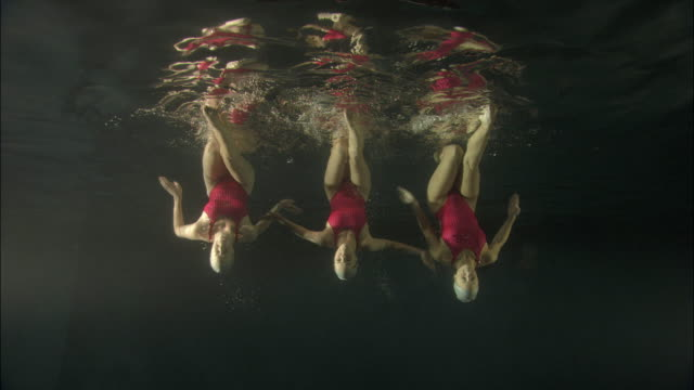 ws, three young synchronized swimmers underwater, basildon, essex, united kingdom - basildon stock videos & royalty-free footage