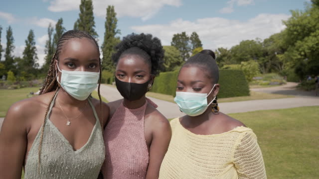 three young woman together wearing face masks - small group of people stock videos & royalty-free footage