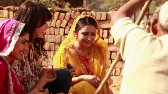 three young women at pottery wheel in a village, haryana, india - haryana stock-videos und b-roll-filmmaterial