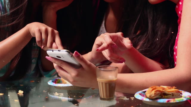 three young women chatting on a mobile phone - messy stock videos & royalty-free footage