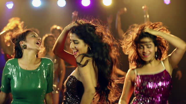 three young women dancing at nightclub party - beautiful woman点の映像素材/bロール