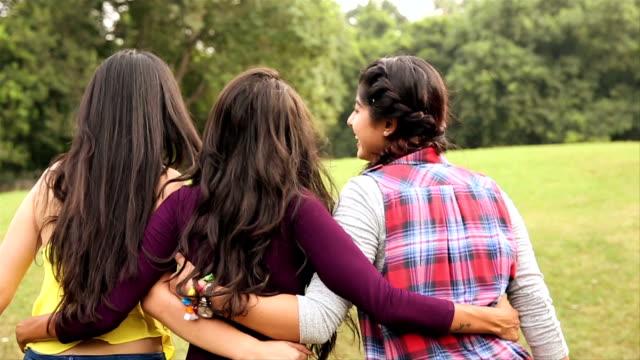 Three young women enjoying in the park, Delhi, India