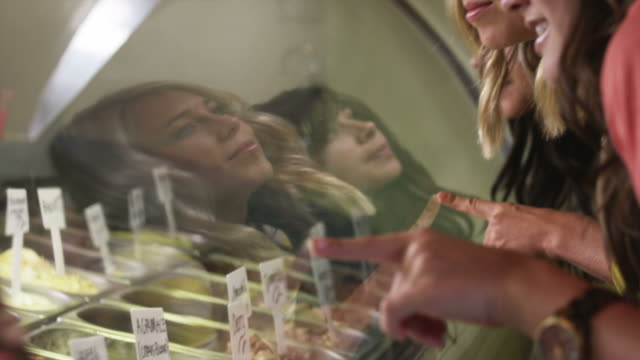 cu tu td three young women looking at ice cream at ice cream parlor, provo, utah, usa - 18 19 years stock videos & royalty-free footage