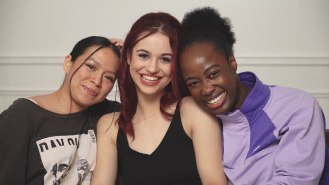 three young women smiling together - human age stock videos & royalty-free footage