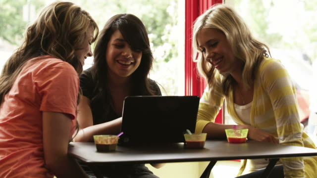 ms tu three young women using laptop in cafe, provo, utah, usa - provo stock videos and b-roll footage