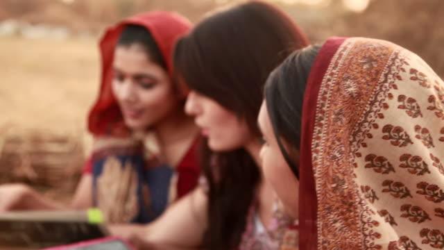 vídeos de stock, filmes e b-roll de three young women writing on a slate, haryana, india - sc47