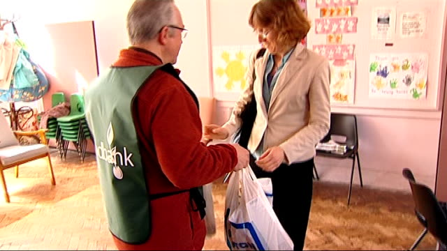 threefold increase in people using food banks; england: derbyshire: int various shots tracey spence talking to a foodbank worker staff member handing... - derbyshire stock-videos und b-roll-filmmaterial
